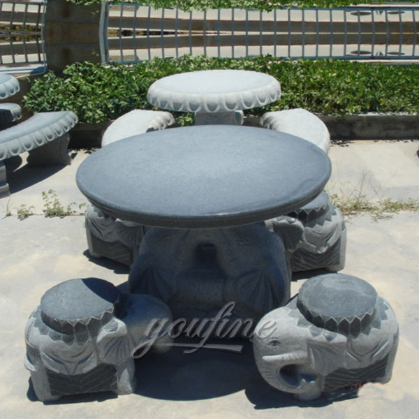 Antique natural round table and elephant chair sit for garden outdoor
