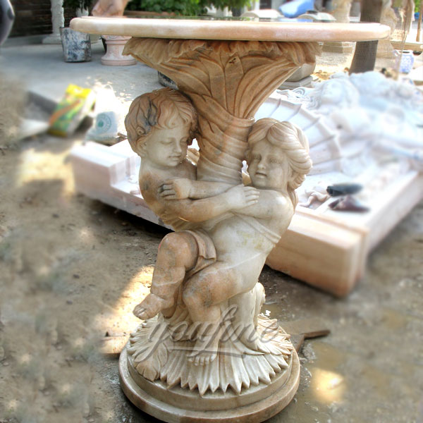 Outdoor beige marble garden table with little children statue i pair for sale